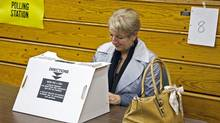 Progressive Conservative Leader Kathy Dunderdale casts her ballot in Newfoundland and Labrador's election at a St. John's polling station on Oct. 11, 2011. (Andrew Vaughan/The Canadian Press)