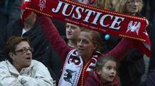 "Members of the crowd react during a vigil at St George's Hall in Liverpool, northern England, September 12, 2012. British Prime Minister David Cameron said on Wednesday he was ""profoundly sorry"" for failures and cover-ups in the wake of the 1989 Hillsborough soccer disaster in which 96 spectators died after a crowd crush in the stadium. (Reuters)"