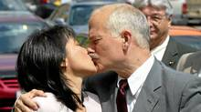 The late Jack Layton kisses his wife, Olivia Chow, as they meet up in Toronto on Wednesday, May 26, 2004. (ANDREW VAUGHAN/ANDREW VAUGHAN/CP)