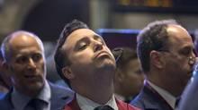 Traders work on the floor of the New York Stock Exchange, October 16, 2013. (BRENDAN MCDERMID/REUTERS)