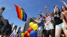 Gay North Region's float's participants dance at the Gay Pride Parade in Toronto. June 30, 2013. (Gloria Nieto/The Globe and Mail)