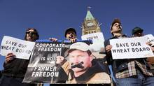 Supporters of the Canadian Wheat Board rally on Parliament Hill in Ottawa on Tuesday. (Sean Kilpatrick/The Canadian Press)