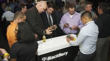 People look at new Blackberry devices at a release party to promote the BlackBerry OS 7 devices in Toronto Aug. 3, 2011. (Mark Blinch/REUTERS)