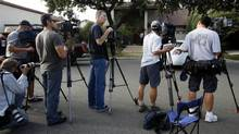 "News media gather outside the home of Nakoula Basseley Nakoula in Cerritos, Calif. Thursday , Sept. 13, 2012. Federal authorities had concluded that Nakoula Basseley Nakoula, 55, was behind ""Innocence of Muslims, "" a film that denigrated Islam and the prophet Muhammad and sparked protests earlier this week in Egypt, Libya and most recently in Yemen (Nick Ut/AP Photo)"