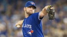 Toronto Blue Jays starting pitcher Todd Redmond works against the Minnesota Twins during first inning AL baseball action in Toronto on Sunday July 7, 2013. (Chris Young/THE CANADIAN PRESS)
