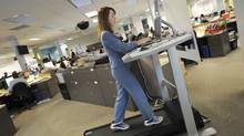 Globe reporter Rebecca Dube is photographed using a treadmill at her workstation in Toronto on Dec. 24/2007. (Kevin Van Paassen/Kevin Van Paassen/The Globe and Mail)