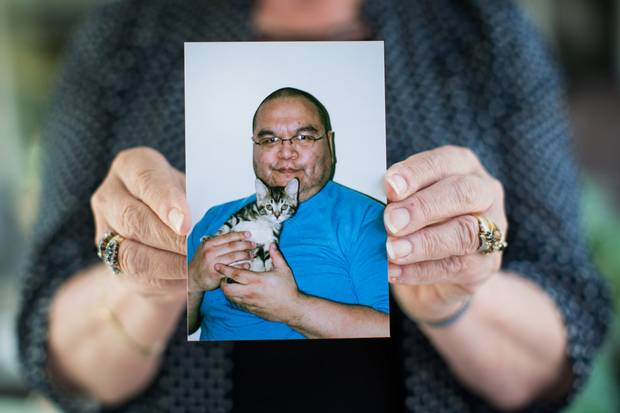 Robyn Batryn of Maple Ridge, B.C., holds up a picture of Phillip Tallio, who has been in prison for 34 years, accused of raping and killing his 22-month-old cousin in 1983. He and his supporters say he's innocent, and now his case is being appealed.