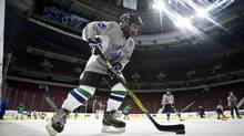 Rahil Velji a Minor hockey players take part in First Strides put on by the Canucks Hockey Team in Vancouver December 5, 2011. (John Lehmann/The Globe and Mail)
