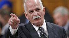 Public Safety Minister Vic Toews said Wednesday that, 'People aren't entitled to pardons, that's something society decides.' (CHRIS WATTIE/REUTERS)