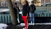Trevlyn Kennedy,19, left, Ashley Fraser,17, centre, and Mustafa Ahmed, right, who take part in programs offered by community service centre Dixon Hall in Regent Park, pose for a photo on Thursday, February 21, 2013. (Michelle Siu/The Globe and Mail)