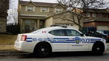 A Peel Police vehicle sits in front of a home in Bolton, Ont. (Peter Power/Peter Power/The Globe and Mail)