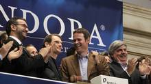 Joe Kennedy (2nd L), president and CEO, and Tim Westergren (2nd R), founder and Chief Strategy Officer of Pandora internet radio, ring the opening bell at the New York Stock Exchange June 15, 2011. (BRENDAN MCDERMID/REUTERS)