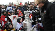 The keeper of the Stanley Cup places it in a sleigh to be skated by youngsters down the Rideau Canal Skateway during the opening ceremonies to the All-Star weekend in Ottawa on Thursday, January 26, 2012. (Sean Kilpatrick/THE CANADIAN PRESS/Sean Kilpatrick/THE CANADIAN PRESS)