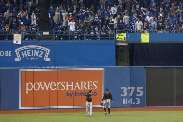 Baltimore Orioles' Hyun Soo Kim, left, and Adam Jones yell at members of the crowd after a beer can was thrown at Kim during play during seventh inning American League wild-card game action in Toronto on Tuesday, October 4, 2016.