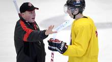 Canada's Ryan Nugent-Hopkins, (right), from Burnaby, BC, talks with head coach Steve Spott, from Waterloo, Ont, during practice for the World Juniors team in Calgary on Saturday Dec. 15, 2012. (Larry MacDougal/THE CANADIAN PRESS)