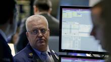Traders work on the floor of the New York Stock Exchange February 3, 2014. (BRENDAN MCDERMID/REUTERS)