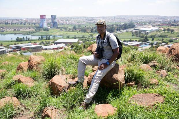Raymond Rampolokeng, seen on Dec. 15, has been leading bird-watching tours in Soweto, South Africa, since 2007.