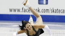 Kaetlyn Osmond of Canada falls during the ladies short program at the Skate Canada International figure skating competition in Saint John, New Brunswick, October 25, 2013. (MARK BLINCH/REUTERS)