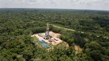 A Petrobras oil well in the Amazon rain forest, 650 kilometres southeast of Manaus, Brazil. (ANTONIO SCORZA/AFP/Getty Images)