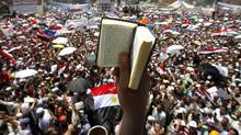An Egyptian protester holds up a Koran while participating in a rally at Tahrir square in Cairo July 29, 2011. (MOHAMED ABD EL GHANY/REUTERS/MOHAMED ABD EL GHANY/REUTERS)
