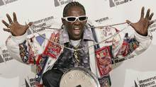 Musician Flavor Flav poses backstage at the 2006 American Music Awards November 21, 2006 in Los Angeles. (LUCY NICHOLSON/Lucy Nicholson for Reuters)