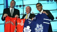 (L-R) George Cope, President and CEO of Bell Canada and BCE, Lawerance M. Tanenbaum, Chairman of Maple Leaf Sports and Entertainment and Nadir Mohamed, President and Chief Executive Officer, Rogers Communication, pose for a photo after announcing a joint ownership arrangement between Rogers and Bell in the purchase of 75% ownership in Maple Leaf Sports and Entertainment. (Brett Gundlock for The Globe and Mail/Brett Gundlock for The Globe and Mail)