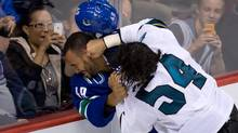 Fans may enjoy hockey fights as a mild form of vicarious sadism. (DARRYL DYCK/THE CANADIAN PRESS)