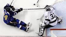 St. Louis Blues' T.J. Oshie, left, tries to reach a loose puck as Los Angeles Kings goalie Jonathan Quick, right, defends during the second period in Game 2 of a first-round NHL hockey Stanley Cup playoff series on Thursday, May 2, 2013, in St. Louis. (Jeff Roberson/AP)