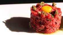 Steak tartare is served at Black and Blue Steakhouse, 1032 Alberni St. in Vancouver. (Laura Leyshon for the Globe and Mail/Laura Leyshon for the Globe and Mail)