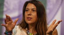 2013 Wimbledon champion Marion Bartoli of France attends a press conference at the All England Lawn Tennis Championships in Wimbledon, London on June 22. (Scott Heavey/AP)