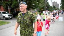 Major Pete Saunders leads a group of children on parade during a nieghbourhood block on his street in Ottawa. Major Saunders is in the Air Force and performs citizenship ceremonies regularly. (Dave Chan for The Globe and Mail/Dave Chan for The Globe and Mail)
