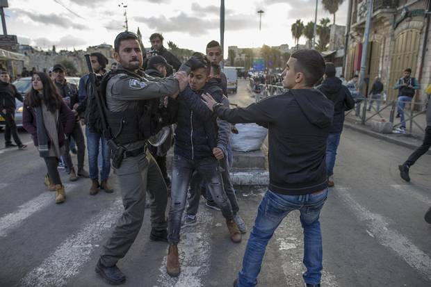 Israeli police clash with Palestinian demonstrators at the Damascus Gate outside the Old City of Jerusalem on Dec. 7, 2017.
