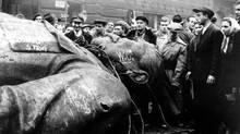 Josef Stalin is toppled, at least symbolically, during the 1956 Hungarian revolt. (AP)