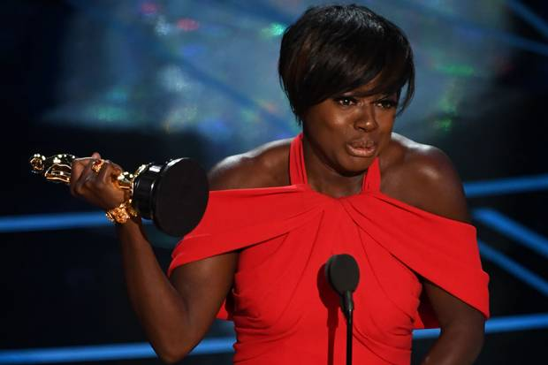 Viola Davis delivers a spech on stage after she won the award for Best Supporting Actress in