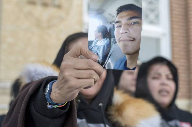 Feb. 5, 2018: Debbie Baptiste, the mother of Colten Boushie, holds up a picture of her son as she leaves court in Battleford, Sask., on a lunch recess on the fifth day of the trial of Gerald Stanley, the farmer accused in Mr. Boushie's death. Mr. Stanley was acquitted four days later.