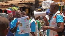 Health workers teach people about the Ebola virus and how to prevent infection, in Conakry, Guinea, March 31, 2014. (Youssouf Bah/Associated Press)