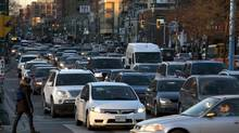 Rush hour traffic on Spadina Avenue near Front Street in Toronto on Nov. 29, 2013. (DEBORAH BAIC/THE GLOBE AND MAIL)