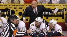 Nashville Predators head coach Barry Trotz, top, argues about a penalty call with referee Marc Joannette (25) as Martin Erat (10), of the Czech Republic, David Legwand (11), Alexander Radulov (47), of Russia, and Patric Hornqvist (27), of Sweden, listen in during the first period in Game 2 in an NHL hockey Stanley Cup Western Conference semifinal playoff series against the Phoenix Coyotes, Sunday, April 29, 2012, in Glendale, Ariz. The Coyotes won 5-3. (Ross D. Franklin/Ross D. Franklin/AP)