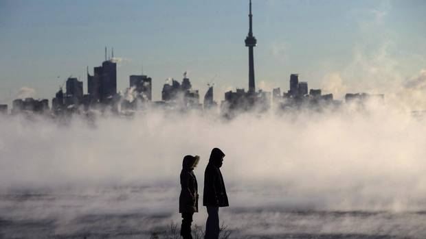 Steam rises as people look out on Lake Ontario in front of the skyline during extreme cold weather in Toronto on Saturday, February 13, 2016. Canada is a land of extremes, from car-freezing cold to crop-searing heat and drenching rains to drought. But you ain't seen nothin' yet. By 2050, within the life expectancy of most Canadians, scientists say that if current emissions levels remain unchanged, climate change will be well established.