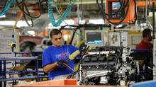 Chrysler employees assemble cars at the assembly plant in Brampton, Ont. The Canadian units of the Detroit Three and the Candian Auto Workers begin new contract negotiations Tuesday. (Kevin Van Paassen/The Globe and Mail)