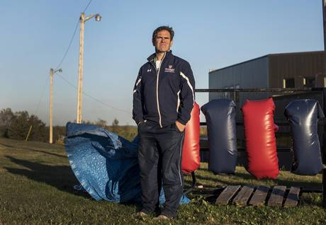 Tantramar Regional High School head football coach Scott O'Neal poses at the school's practice field in Sackville, N.B., on Thursday. 'The concussion epidemic is due to players not being properly prepared for competition,' he says.
