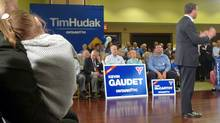 With wife Deb Hutton and daughter Miller looking on, Tim Hudak campaigns in Ajax, Ont., on Sept. 6, 2011. (Steve Ladurantaye/The Globe and Mail)