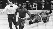 This March 8, 1971, file photo, shows boxer Joe Frazier being directed to the ropes by referee Arthur Marcante after knocking down Muhammad Ali during the 15th round of the title bout at Madison Square Garden in New York. Former heavyweight champion Joe Frazier is seriously ill with liver cancer. His personal and business manager says Saturday, Nov. 5, 2011, the 67-year-old boxer was diagnosed four or five weeks ago and is under hospice care. (AP Photo, File) (AP)