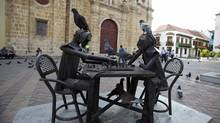 Pigeons stand on a sculpture of chess players on April 11, 2012, inside Cartagena's old city. Colombia plays host to the Summit of the Americas from April 14 to 15. (RICARDO MORAES/REUTERS)