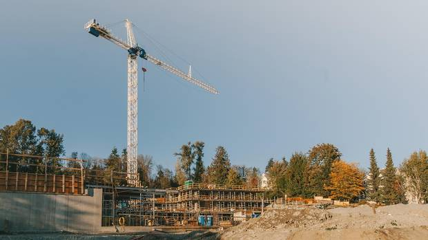 A crane works on a project under construction by the Co-op Federation along the Fraser River.