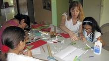 Barbara Dunsworth makes Christmas cards with children at the Children's Centre in Managua.