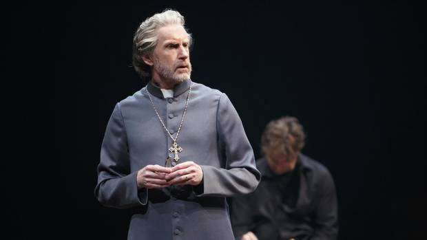 Directed by Antoni Cimolino and Shelagh OBrien. Credit: Stratford Festival. Tom Rooney as Polonius with Jonathan Goad, background, as Hamlet in Hamlet.