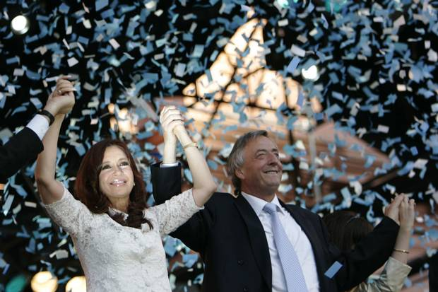 Argentina's newly elected president Cristina Fernandez de Kirchner, left, and her husband, outgoing president Nestor Kirchner, raise their arms during a music festival in front of the presidential palace in Buenos Aires after she was sworn in Dec. 10, 2007. Ms. Fernandez de Kirchner left the presidency in 2013.