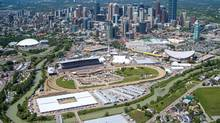 The grounds of the Calgary Stampede is shown in this aerial photo with the city of Calgary, Alta., in the background on Saturday, July 07, 2012. (Chris Bolin/THE CANADIAN PRESS)