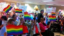 Attendees at a meeting of Vancouver school trustees on June 16, 2014, made themselves visible and vocal. (Alexandra Posadzki/The Globe and Mail)